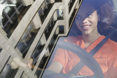 Young woman driving car - FSIF03447