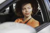Confident young woman driving car - FSIF03456