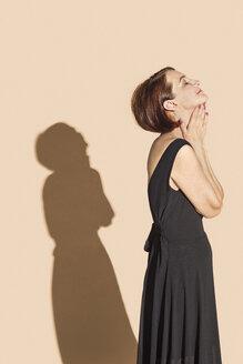 Serene woman in black dress - FSIF03543
