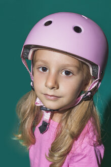 Close up portrait confident girl wearing pink helmet - FSIF03636