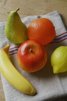 Plastic fruits on towel - FSIF03672