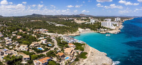 Spain, Baleares, Mallorca, Porto Colom, Aerial view of Cala Tropicana and Cala Domingo - AMF06485