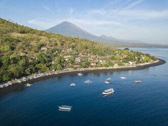 Indonesia, Bali, Amed, Aerial view of Jemeluk beach and volcano Agung - KNTF02568