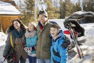 Happy family on ski holiday - HEROF00817