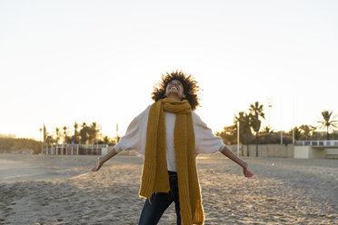 Happy woman having fun on the beach at sunset - AFVF02163