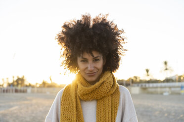 Portrait of a happy woman in the beach, wearing a yellow scarf - AFVF02166