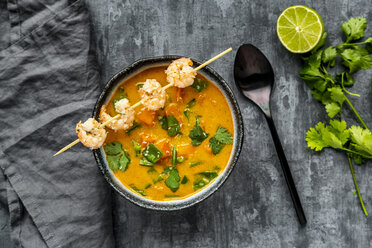 Bowl of sweet potato soup with  shrimps, coconut flakes and fresh coriander - SARF04019