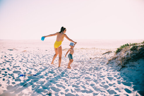 A mother and son playing at the beach on a sunny day - INGF10596