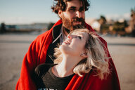 Portrait of a happy young couple standing outdoors - INGF10617