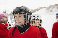 Smiling ice hockey player looking away - HEROF01367