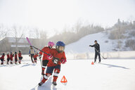 Ice hockey players training on outdoor skating rink - HEROF01571