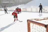 Ice hockey team practicing on rink - HEROF01613