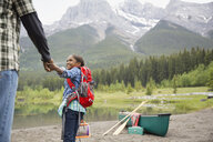 Father and daughter preparing to canoe - HEROF01697
