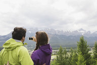 Couple photographing mountain view - HEROF01754