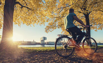 A man riding a bicycle in the park - INGF10918
