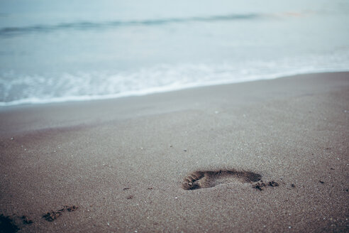 Scenic view of a footprint in the sand at the beach in Spain - INGF10975