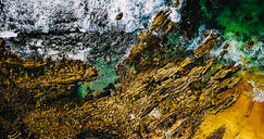 Close-up textured shot of rocks by the sea - INGF11020