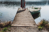 A person walking to the end of the pier on a lake - INGF11062