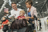 Family of three looking forward to their holiday at CGN airport, Cologne, NRW, Germany - MFF04715
