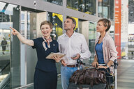 Couple asking member of ground crew about their gate at CGN airport, Cologne, NRW, Germany - MFF04727