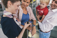 Member of ground crew scanning QR codes of passengers smart watch at CGN airport, Cologne, NRW, Germany - MFF04733