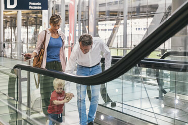 Family on the escalator at the airport - MFF04745