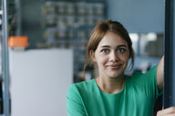 Portrait of smiling woman in office - KNSF05453