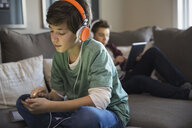 Boy listening to music on smart phone - HEROF01867