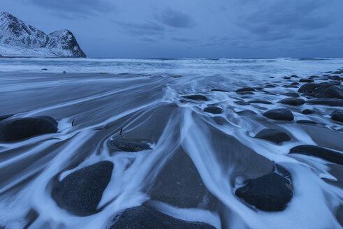 Rocks on beach in winter, Unstad beach, Vestvagoya, Lofoten Islands, Norway - AURF07915