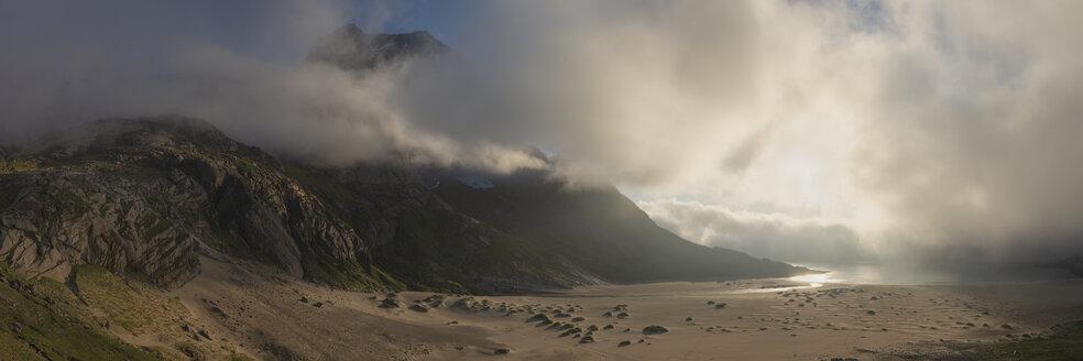 Storskiva peak behind fog and Bunes beach, Moskenesoya, Lofoten Islands, Norway - AURF07930
