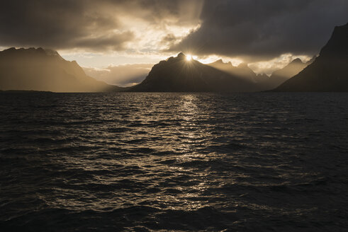 Mountains across sea at sunset, Reine, Moskenesoya, Lofoten Islands, Norway - AURF07933
