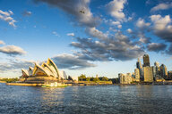 Australia, New South Wales, Sydney, Business district and Sydney Opera House in the evening light - RUNF00529