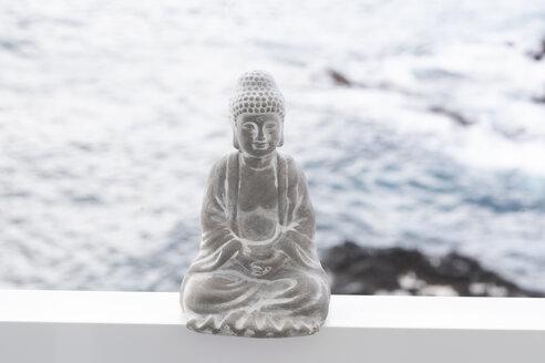 Concrete buddha figure, ocean in the background - CHPF00524