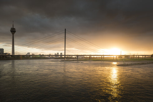 Germany, Duesseldorf, Oberkassel Bridge with Media Harbour in the background at twilight - SKAF00095