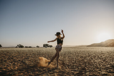 Namibia, Namib desert, Namib-Naukluft National Park, Sossusvlei, woman moving at sunset at Elim Dune - LHPF00232