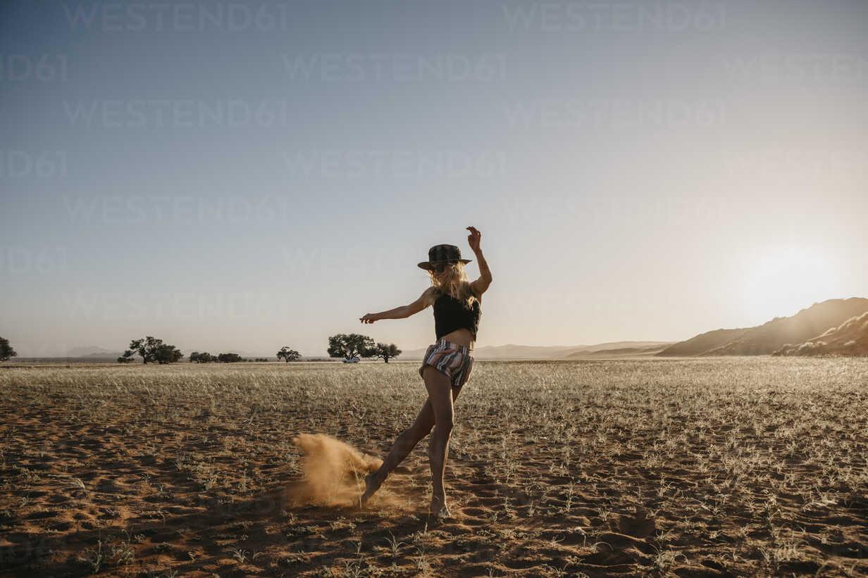 Namibia, Namib desert, Namib-Naukluft National Park, Sossusvlei, woman moving at sunset at Elim Dune - LHPF00232 - letizia haessig photography/Westend61