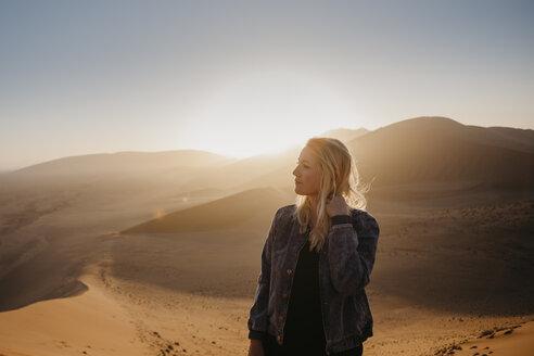 Namibia, Namib desert, Namib-Naukluft National Park, Sossusvlei, woman Dune 45 at sunrise - LHPF00241