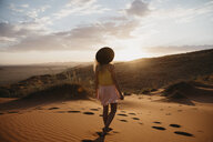 Namibia, Namib desert, Namib-Naukluft National Park, Sossusvlei, woman walking on Elim Dune at sunset - LHPF00256