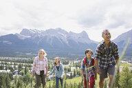 Family hiking on rural hillside - HEROF02076