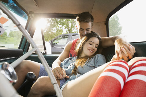 Couple relaxing together in truck - HEROF02133
