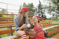Couple talking in bleachers - HEROF02136