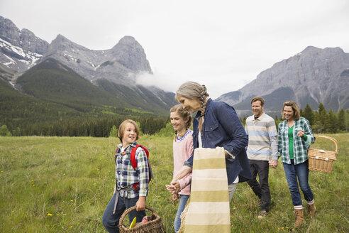 Family having picnic in rural field - HEROF02169