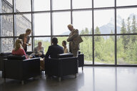 Business people meeting in office lobby - HEROF02235