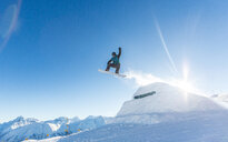 Action shot of a skier on a snow capped mountain in winter - INGF11333