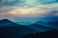 Scenic view of mountains under a beautiful colorful sky in Germany - INGF11444