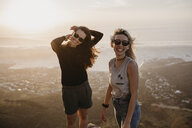 South Africa, Cape Town, Kloof Nek, portrait of two happy women at sunset - LHPF00297