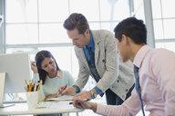 Business people meeting at desk in office - HEROF02587