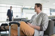 Man waiting in airport - HEROF02803
