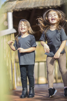Two happy girls laughing and playing - ZEF16071