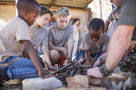 Children learning how to make a fire - ZEF16077